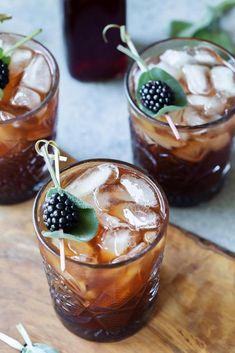 Sparkling Tea Cocktails Garnished with Sage & Blackberry