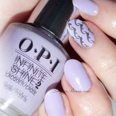 Nailartist Melissa G. amps up her solid lavander mani with a swirly accent on a single nail. Using her gifts from OPI, this new #InfiniteShine line is just literally radiant, with its gel-like gloss.