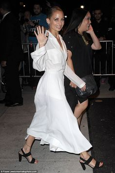 Taking the plunge: Nicole wowed as she stepped out in a collared plunging white gown