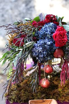 Blue and red floral centerpiece | Seen Photography | see more on: http://burnettsboards.com/2015/05/bold-floral-inspired-wedding-editorial/