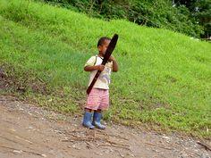 Village boy ready for some weeding.
