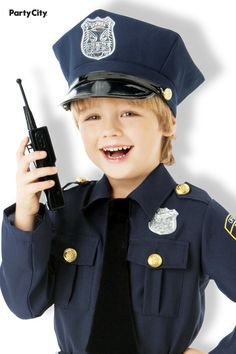 This protector of the peace has it all under control! He also has the look of authority: Boys Classic Police Officer Costume features a realistic scaled-down police shirt with attached silver badge, button-down chest pockets and epaulettes, and an attached black neck tie. The shirt comes with matching pants; a matching police hat with badge, a faux leather belt with holster, and a toy walkie-talkie complete the outfit. Police Officer Costume, Police Hat, Police Shirts, Black Neck, Faux Leather Belts, Walkie Talkie, Badge, Captain Hat, Halloween Costumes