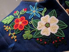 """2013 Métis (First Nations) Jacket (detail) at the McCord Museum, Montreal - From the curators' comments: """"Artist Briony Goddard made this hide jacket. Her designs, worked in vintage and contemporary glass beads, incorporate traditional floral elements, which she intersperses with plants and flowers found locally in the client's home region. The result is a new hybrid design - stunning evidence of the artist's flexibility."""""""