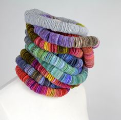 Kate Ramsey Felt: Felted Disc Necklaces stacked up and ready to be uploaded on Etsy