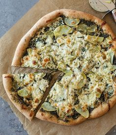 Potatoes become a buttery treat that's the basis of a delicious meatless Monday meal. The kale pesto moistens the dough and gives the pizza a satisfying, earthy flavor.