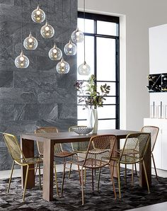 Love the lighting above the dining table, the chairs have that stylish mid century look.