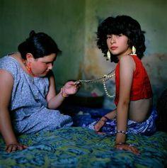 Magnum photographer Alessandra Sanguinetti - the image titled The Necklace 1999 - captures joy + envy