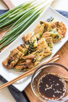 This recipe for Korean Pancakes (called Pajeon or Pa Jun) with Scallions and Dipping Sauce is wonderful for a snack, appetizer or light lunch. The tender scallions impart a fresh, mild bite without making the Veggie Recipes, Indian Food Recipes, Asian Recipes, Vegetarian Recipes, Cooking Recipes, Asian Desserts, Korean Scallion Pancake, Korean Pancake, Scallion Pancakes