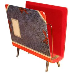 Magazine Rack by Piero Fornasetti, 1950's| From a unique collection of antique and modern magazine racks and stands at http://www.1stdibs.com/furniture/more-furniture-collectibles/magazine-racks-stands/