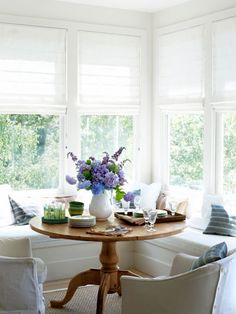To create a dining nook, pull up a pedestal table and armchairs to built-in benches.