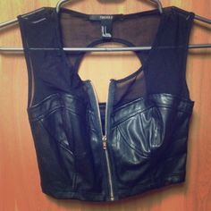 Pleather Crop Top Pleather bustier crop top with mesh collar and zipper . Brand new condition! Super cute and sexy perfect for going out! Please feel free to make an offer I'm always willing to negotiate! Forever 21 Size: Small Forever 21 Tops Crop Tops