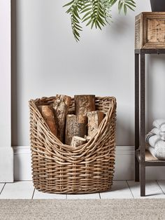 Crafted from chunky round rattan for a rustic finish, our simple asymmetric log holder is the perfect fireside storage solution. Each features a generous capacity for storing logs without compromising on space or style in your living space. Log Burner Accessories, Fireplace Accessories, Living Room Accessories, Home Accessories, Indoor Log Storage, Indoor Log Holder, Firewood Holder, Firewood Basket, Log Burner Living Room