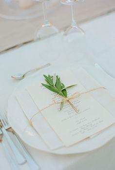 Classic wedding menu card adorned with a fresh sprig of sage (Photo: Kate Headley)