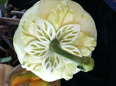 These pumpkins make great centerpieces!      A white pumpkin carved by Carl Jones  click on pumpkin to see info on classes!