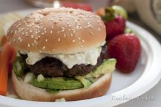 Burgers made with bacon and roasted peppers, dripping with a queso cheese sauce and loaded with an avocado salsa.