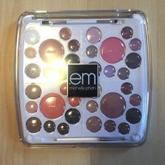 The Life Palette - Career Life EM by Michelle Phan. Some colors have been SWATCHED otherwise in like new condition. Comes with travel compact. Palette is 0.948 oz. /26.8 g and made in Canada. I don't have the cardboard packaging it came in. 0.948 oz. /26.8 g. No trade. EM Makeup Eyeshadow