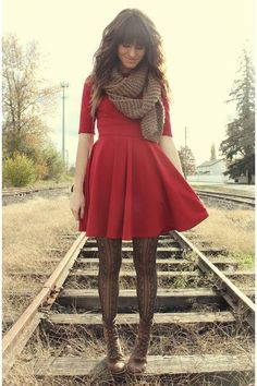 Red and tan. Flared Dress with tights.