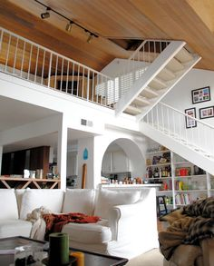 I like the open space, the wooden ceiling and stairs taking to the loft