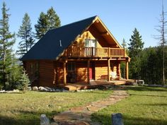 FSBO Kalispell Montana - Custom Log Home with Spectacular Views - Custom-built, chalet-style, hand-hewn log home on 5.73 acres with privacy and spectacular views of the valley and surrounding mountains. River rock fireplace, custom wood floors, and vaulted ceiling. Top-of-the-line Heartland range, dual ovens, stainless steel appliances, dual-tank water conditioner system, large jetted bathtub, and 16-channel security camera system.