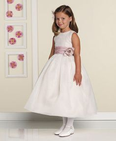 Sweet Flower Girl Dresses. A simple and sweet design by�Joan Calabrese for Mon Cheri�is just perfect for your flower girl. This sleeveless organza and iridescent taffeta tea-length dress with organza overlay bodice and box pleated skirt has a ruched taffeta waistband and sash that ties in the back. The flower accent is removable. Available in white, ivory or caf�/rose in sizes 2 to 16 and 8 1/2 to 14 1/2. Style No. 19307, $150. Visit�calabresegirl.com�to find a store in your area.