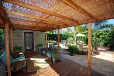 cool idea for pergola cover, and I love the wood decking vs. stone