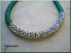 Unicorniopasion:  Bead crochet with focal of crocheted crystal bicones