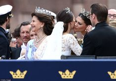 Princess Sofia kissed her new sister-in-law, Crown Princess Victoria (right) as Prince Carl Philip (left) spoke to his mother, Queen Silva