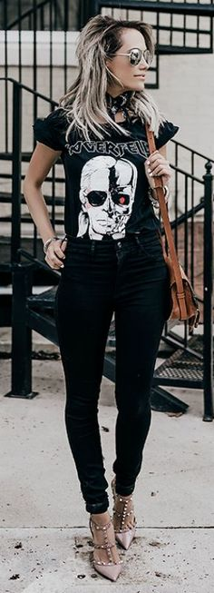 A graphic print tee + ultimate rocker girl item + authentic rocker style + absolute must have + Megan Anderson + everyday rock chick look + tee with skinny black jeans + stud detailed heels.   Top: StyleStalker, Denim: ASOS, Shoes: Valentino, Bag: Chloe, Sunnies: Le Specs.