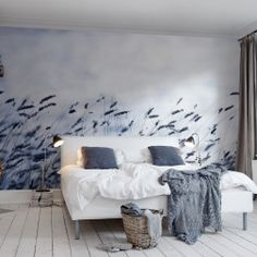 A sea of grass in Gotland surges across this wallpaper in shades of blue, inspiring calm and clarity.