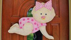 It's a Girl Burlap Door Hanger. $30.00, via Etsy.
