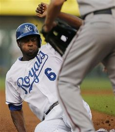 Lorenzo Cain (6) slides into third base during the first inning of a baseball game against the Minnesota Twins at Kauffman Stadium in Kansas City, Mo., Monday, Aug. 5, 2013. Cain advanced on a single by teammate Billy Butler. (AP Photo/Orlin Wagner)