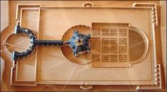 MAULNES Maquette.- III - LES ENIGMES DE MAULNES. 1) LE PLAN, 3: C'est un élève de Peruzzi, Sebastiano Serlio, venu en France en 1541, qui présente dans son Livre VI les plans du palais pentagonal. Et c'est cet architecte que choisit Antoine de Clermont, le frère de Louise de Clermont, pour construire un château à Ancy le Franc dans les années 1541-1550. On ne peut pas exclure que le couple Du Bellay ait eu connaissance de ces plans.