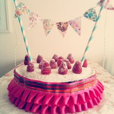 pretty birthday cake with a ruffled skirt and bunting~