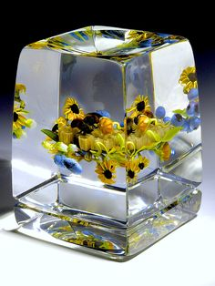 """Paul Stankard Botanical Study Vertical Paperweight, on a clear ground featuring spray of black-eyed susans, blueberries, honeycomb, bees, incised above foot """"Paul J. Stankard S1 S93"""", 2 5/8""""square x 3 3/8""""tall, 30.5oz. - #0011"""