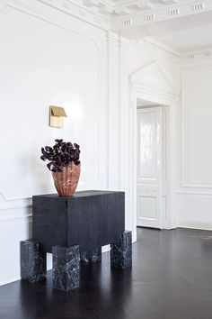 KELLY WEARSTLER | FLUTED MARBLE VASE. Large hand-sculpted fluted marble vase in Russet. Also available in Negro Marquina and White Calacatta
