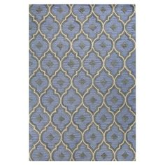 An artful anchor for a vibrant space or touch of texture in a neutral room, this hand-tufted wool rug showcases a chic quatrefoil trellis motif in light blue...