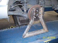 """Jackstands by MARTINSR -- Homemade jackstands constructed from 2""""x1/4"""" angle iron. A range of attachment holes enables the stand to be adjusted to accommodate different lug spacing. http://www.homemadetools.net/homemade-jackstands"""