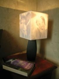 DIY Family pictures lamp shade...in daylight its a normal lamp shade...at night turn it on and your pictures appear!