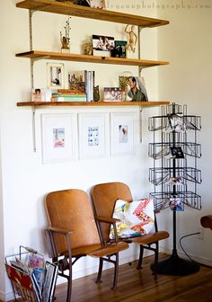 """How cool is this designed by Ashley from Under the Sycamore!  I would love to find an old """"post card"""" stand to display photos!"""