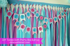 DIY Party Backdrop Tutorial: Cheap & Easy {rainonatinroof.com} #party #DIY #backdrop #tablecloth #decoration #tutorial