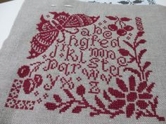Marjorie Massey cross stitch sampler in redwork