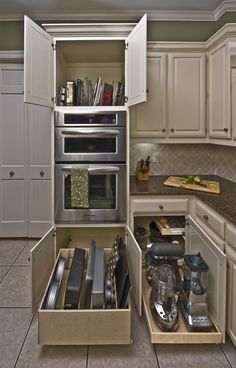#BakingTrays below the oven, #ServingTrays above, and #KitchenAppliances beside. It's a #ShelfGenie kitchen, complete with #TrayDividers, #RollOutTrayBins and a #BlindCornerSolution.