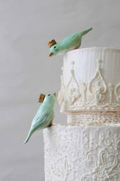 White wedding cake with 2 blue birds on the side of the cake! Beautifully done!