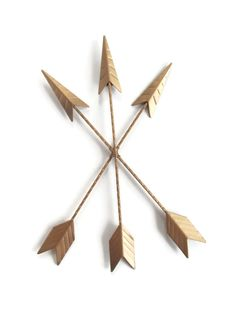 Three metal arrows are bound in the middle to form this decorative piece. This super trendy piece will add the finishing touch to nearly any decor.