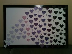 """Use a large foam board from Michaels ($1.00),  heart paper punches (had), paint samples from Home Depot (had), double sided sticky dots (had) and """"framed"""" it using black duct tape (had).  Perfect gift for my sister who is purple obsessed (and I LOVE anything ombré!)! She loved it!"""