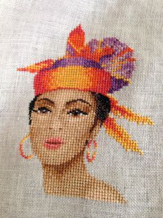 This is Dominique by John Clayton. I love the purple, orange, and reds in this. Cross Stitch Gallery, John Clayton, Mood Colors, Cross Stitch Supplies, Crossstitch, Point, Cross Stitching, Fabric Patterns, Cross Stitch Patterns