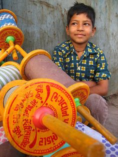 Minding reels of kite string , India