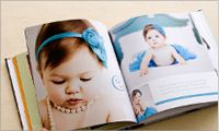 "Have people write messages on a photo book as a ""guest book"" for birthday baby."