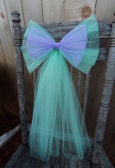 This beautiful, extra large tulle pew bow is customized to match your theme/venue. Over 3 yards of quality tulle are used to make each double loop bow. This multi colored bow measures approximately 15-16 inches wide and is 9 inches tall. Bow is approx. 27 from top to bottom. Smaller top