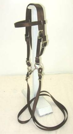 "MINIATURE HORSE / SMALL PONY NYLON BRIDLE BROWN by PARTY PONIES. $19.99. Beautiful double ply web bridle. Current style has one point adjustment. 8' rein and 3.5"" snaffle bit.  Measures 32"" from bit attachment, around ears, to other side at largest setting. 25"" at smallest.  This bridle comes in 16 colors and two sizes; Miniature Horse/Sm Pony or Pony size."